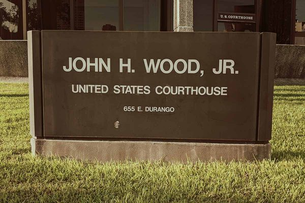 Sign at John H. Wood Federal Courthouse in San Antonio, Texas. Federal Classification of Crimes.
